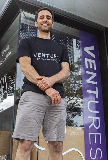 Yotam standing in front of the Ventures space