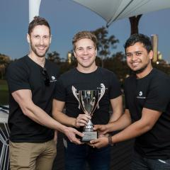 SportsCube co-founders with their winning trophy.
