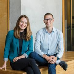 bloom impact investment founders sitting for portrait