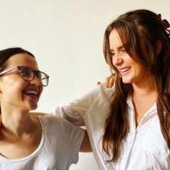 Ashley Baxter and Phoebe Long smiling and laughing at one another.