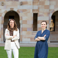 UQ women standing proudly in front of UQ's Great Court