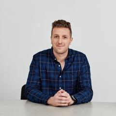 Daniel Flynn Founder of Thankyou sitting at table