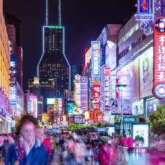 busy shanghai street with neon lights